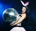 Sexy bunny girl with disco ball young Royalty Free Stock Image