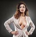 Sexy businesswoman on gray background portrait of a posing Stock Images