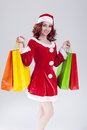 Sexy Caucasian Ginger Santa Helper Girl with Plenty of Colorful Shopping Bags Royalty Free Stock Photo