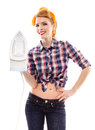 Sexy cheerful housewife holding a flat iron with hand on hip isolated over white background Royalty Free Stock Photos