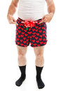 Sexy christmas gift guy in boxers humorous photo of a boxer shorts with a bow offering his crotch as a isolated on white Stock Photos