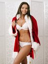 Sexy christmas gift photo of a beautiful woman in her underwear posing with a santa claus jacket as a Royalty Free Stock Images