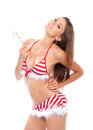 Sexy christmas girl in red stripped bikini Stock Image