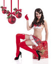 Sexy christmas girl sitting on a huge gift box Royalty Free Stock Image