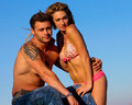 Sexy couple at the beach caucasian pose Stock Photos
