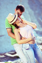 Sexy couple loving on the rocky coast Royalty Free Stock Images
