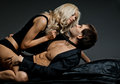 Sexy couple muscular handsome guy with pretty woman on dark background glamour light Stock Photos