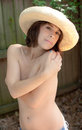 Sexy in cowboy hat a portrait of a topless young woman outdoors a Stock Image
