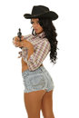 Sexy cowgirl picture of with a gun on white background Royalty Free Stock Photo