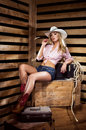 A sexy cowgirl posing in a hat Royalty Free Stock Photo
