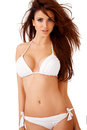 Sexy curvy brunette in a white bikini Royalty Free Stock Photo