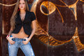 Sexy dirty blonde girl light brown hair woman fashion model standing in front of a rusty metal wall with urban graffiti wearing Royalty Free Stock Photography