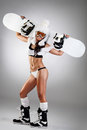 Sexy dressed snowboarder woman with snowboard Stock Photo
