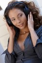 Sexy ethnic woman with headphones Royalty Free Stock Photography