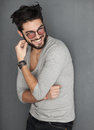 Sexy fashion man with beard dressed casual smiling against wall Royalty Free Stock Images