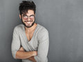 Sexy fashion man with beard dressed casual smiling against wall Stock Photos
