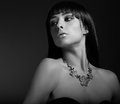 Sexy fashion model in necklace on dark background black and white portrait Royalty Free Stock Photography