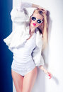 Sexy fashion woman model dressed white wearing sunglasses posing glamorous studio Stock Photo