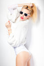 Sexy fashion woman model dressed in white wearing sunglasses posing glamourous in the studio Royalty Free Stock Photo