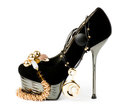 Sexy fashionable shoe with golden jewelry Stock Photography