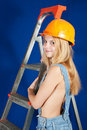 Sexy  female  builder  with stepladder Royalty Free Stock Photography