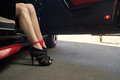 Sexy female legs in a car Royalty Free Stock Photo