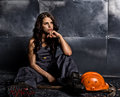 Sexy female miner worker with pickaxe, in coveralls over his naked body. erotic industry concept Royalty Free Stock Photo
