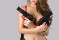 Sexy female model holding guns Royalty Free Stock Photo