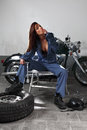 Sexy female motorcycle mechanic Royalty Free Stock Images