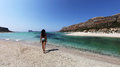 Sexy girl on a beach with turquoise clear waters panoramic landscape from balos lagoon crete greece looking woman moving towards Stock Photography