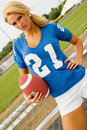 Sexy Girl Blonde in Football Jersey Royalty Free Stock Image