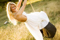 Sexy Girl Blonde on Tire Rope Swing Royalty Free Stock Photo
