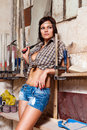 Sexy girl in the carpentry shop carpenters Royalty Free Stock Images