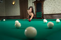 Sexy girl in corset plays billiards russian pyramid Stock Image