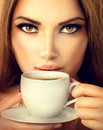 Sexy girl drinking tea or coffee beautiful Royalty Free Stock Photos
