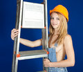 Sexy girl in hardhat with stepladder Royalty Free Stock Photography