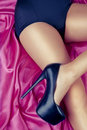 Sexy girl with high heels on satin Royalty Free Stock Photography