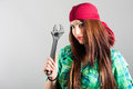 Sexy girl holding adjustable wrench portrait of Stock Image