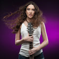 Sexy girl holding guitar Royalty Free Stock Photo
