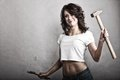 Sexy girl holding hammer and wrench spanner Royalty Free Stock Photo