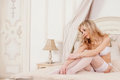 Sexy girl in lingerie in the bed beautiful underwear interior Royalty Free Stock Photos