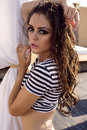 Sexy girl with long wet hair posing on summer beach fashion photo of glamour woman dark in striped shirt Royalty Free Stock Photography
