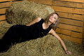 Sexy girl lying on hay Royalty Free Stock Images