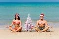 Sexy girl man Santa on a beach fir-tree Royalty Free Stock Photo
