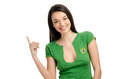 Sexy girl pointing up attractive with brazilian flag on her green t shirt isolated on white Royalty Free Stock Images