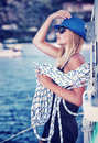 Sexy girl on sailboat standing with rope vintage style photo of attractive sailor active lifestyle summer vacation concept Royalty Free Stock Images