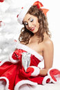 Sexy girl smiles and holding a gift Royalty Free Stock Photos