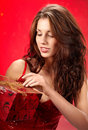 Sexy girl smiles and holding a  gift in box Royalty Free Stock Images