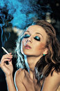 Sexy girl smoking Royalty Free Stock Photo