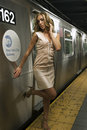 Sexy girl standing at nyc subway in front of train Royalty Free Stock Images